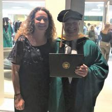 Carrie Pettus-Davis celebrates Bill Rone on his MSW graduation in May 2019 from The Brown School at the Washington University in St. Louis